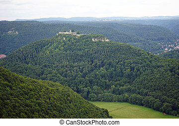 Ruins on the hill - Ruins on the top of forested hill in...