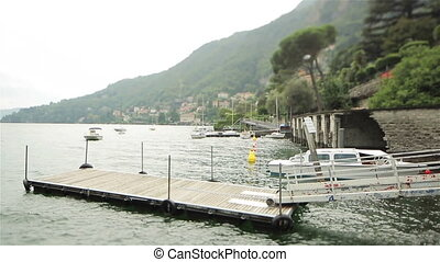 Small wooden pier on the lake Como