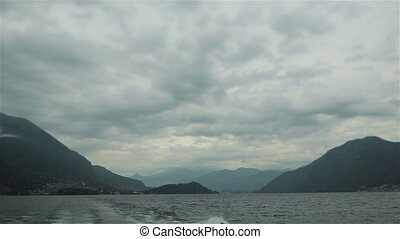 View of mountain lake from motor boat - Back view from motor...