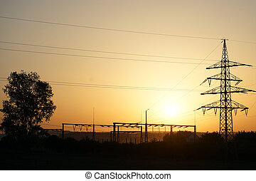 Sunset and pylon - Tree and electrical station with sunset...