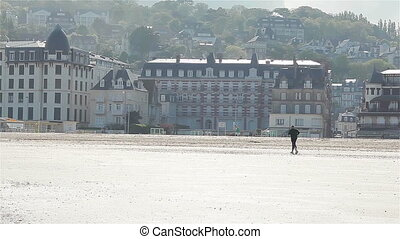Man jogging on beach in Trouville