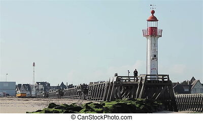 Lighthouse and pier in french harbor - Lighthouse and pier...