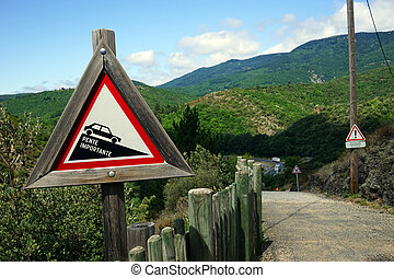 Road sign and mountain in France