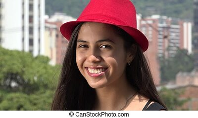 Teen Girl Posing with red Hat