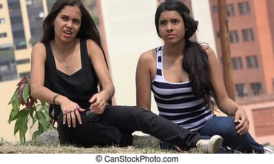 Teen Girls Sitting and Listening
