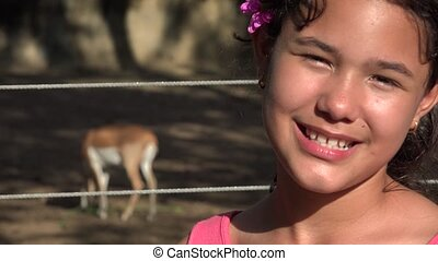 Girl Posing with Deer at Zoo