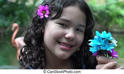 Teen Girl Holding Colorful Flowers