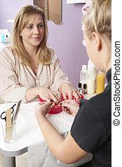Woman Having Manicure At Beauty Salon
