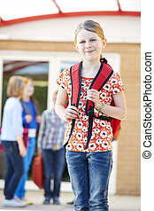 Girl Standing Outside School With Rucksack