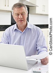 Concerned Senior Man Looking At Personal Finances