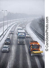 Snowplough Clearing Motorway During Winter
