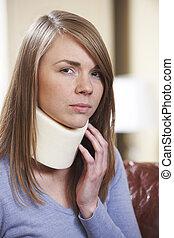 Woman In Pain Wearing Neck Brace