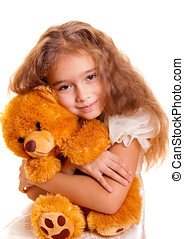 Little Girl And Teddy Bear - A cute little girl embracing...