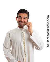 Middle eastern arab man using the telephone