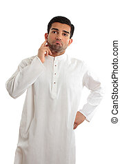 Worried troubled ethnic man wearing a kurta - A middle...