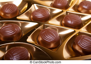 chocolate candy in golden foil