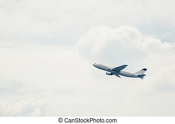 departure of an aircraft, white sky background