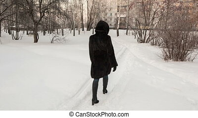 Girl in a black fur coat - the girl in a black fur coat goes...