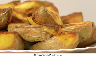 baked sliced potatoes - baked potato slices in the peel,...