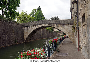 Embankment and old arch bridge in Old town Dole, France...
