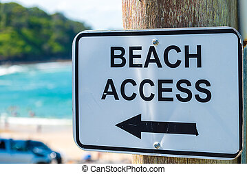 Beach Access Sign with Arrow on a pole