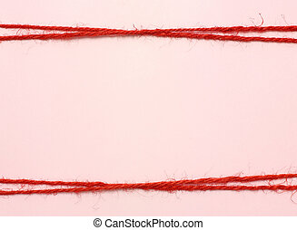 String red as frame on pink background