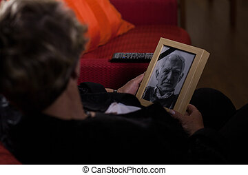 Widow mourning dead person - Portrait of elderly widow...