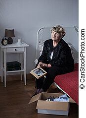 Grieving woman after funeral - Photo of grieving lonely...
