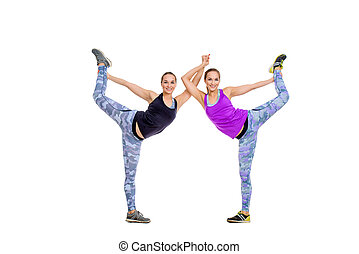 gymnastic duo - Two athletic girls in sportswear perform...