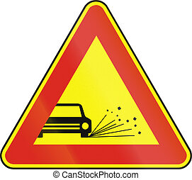Road sign used in Slovakia - Loose chippings as a temporary...