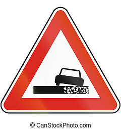 Road sign used in Slovakia - Dangerous roadside