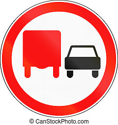 Road sign used in Russia - No overtaking by heavy goods...