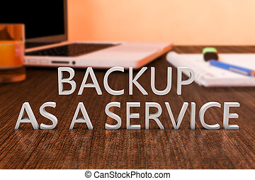 Backup as a Service - letters on wooden desk with laptop...