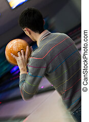 Bowler throwing a ball in blured motion