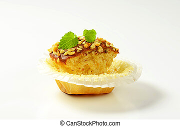 Hazelnut muffin - half eaten - Muffin topped with chocolate...