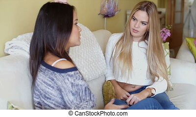Two young woman in a serious discussion