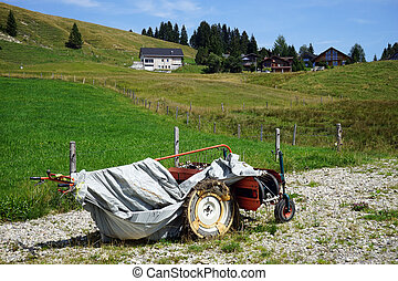 Motor plough on the farm field in Switzerland