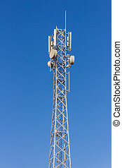 Telecommunication tower with antennas with blue sky