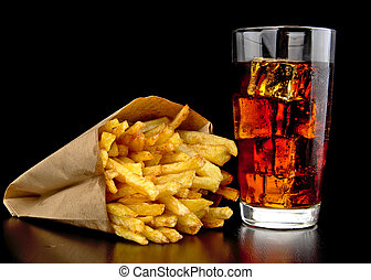 Big cheeseburger with french fries on black desk