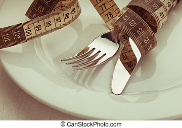Cutlery on a plate - Fork and knife with meter on the empty...