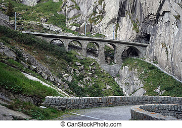 Railway bridge and slope near Andermatt in Switzerland...