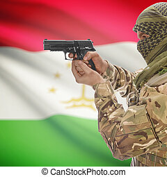 Male with gun in hand and national flag on background -...