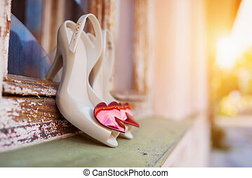 Bridal shoes on window parapet - Bridal shoes with red...