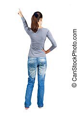 Back view of pointing woman. beautiful brunette girl in...