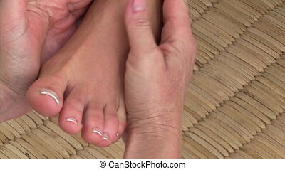 Close-up of a foot massage in a spa center