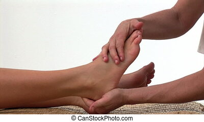 A woman enjoying a foot massage