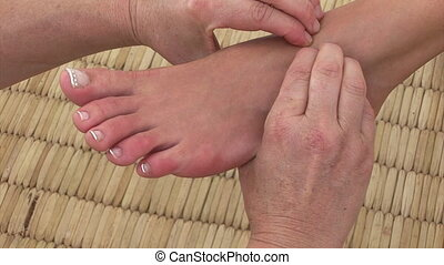 A professional foot massage - Close-up of a professional...
