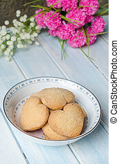 Heart-shaped butter cookies Aged blue wooden background