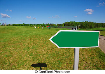 Empty arrow signpost along road