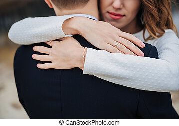 Young woman embracing her boyfriend - Closeup of happy young...